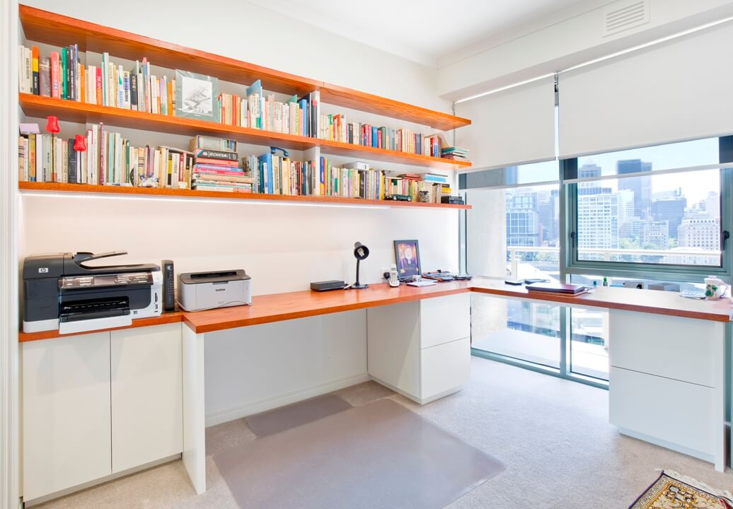 Four File Drawers Two Storage Cupboards And Floating Shelves Above Led Strip Lighting Illuminates Desk Against Wall Cable Management Throughout